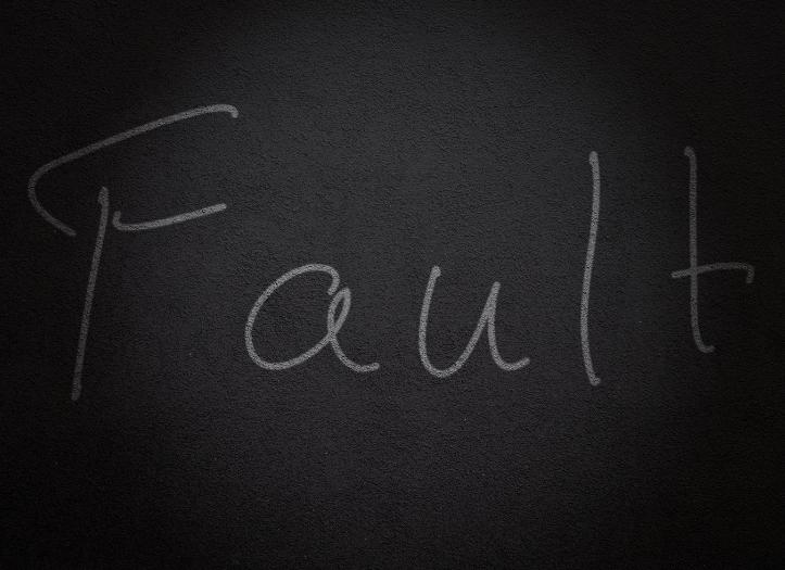word fault written on chalkboard
