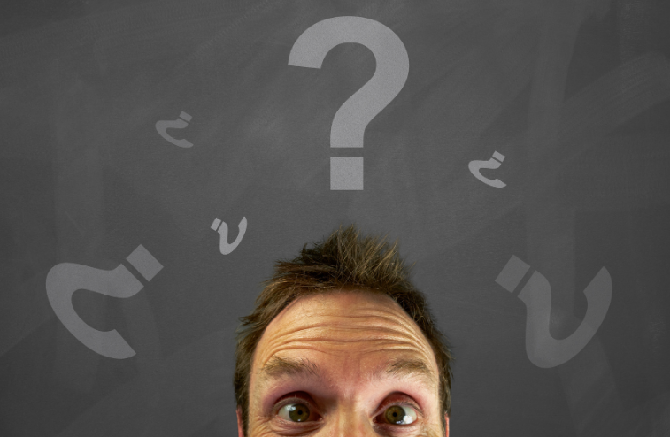 man with question marks surrounding him